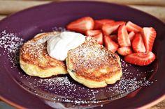 Syrniki- Ukrainian cheese pancakes. A wonderful dessert or breakfast food. Serve with fresh fruit and sour cream!