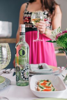 Set the tone of your party with a festive sundress and a toast to your guests! #EccoDomani #DressedbyZac #PinotGrigio
