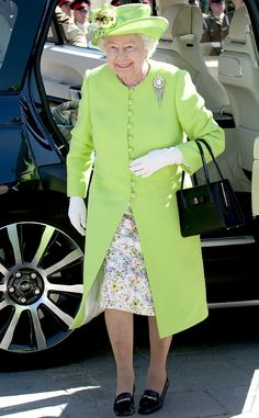 2014 The Queen attended another Service of Remembrance in a lime-green coat and hat, which she wore over a floral-print dress.