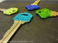 Mod Podge, glitter, and clear nailpolish = glitter keys!!!  I am a FREAK about glitter! Love this!