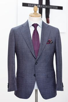 The prime pleasure in a business suit is neither the colour nor its design but more importantly the fit and the cut of the suit. However - from a business point of view - a grey suit is almost as versatile as a navy one. The descent Prince of Wales (POW) check adds a classy and elegant touch to this grey suit. A POW check suit has a timeless style and certainly is an icon of British heritage. It deserves to be part of every gentleman's evenhandedly practical and elegant wardrobe. #businesssuit # Cutaway, Smoking, Frack, Bespoke Tailoring, Prince Of Wales, Timeless Fashion, Mantel, Gentleman, Suit Jacket
