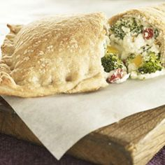 Broccoli Three-Cheese Pizza Pockets  Just Grab & Go: Broccoli, peppers, and three cheeses make a tasty filling for this pizza pocket. Best of all, it's ready in 35 minutes.