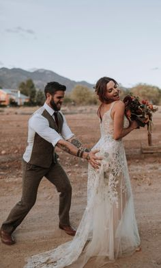 Gypsy Rose Gown Gypsy Rose Gown,Beauty together Hamming it up in Claire Pettibone floral Gypsy Rose wedding dress with ecru embroidered tulle layered over colorful rose and sage embroidery with sweeping train. Unique Wedding Gowns, Rose Wedding, Dream Wedding, Wedding Ideas, Wedding Groom, Gypsy Wedding Dresses, Bali Wedding Dress, Army Wedding, Wedding First Look