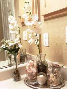 Look Over This A beach themed bathroom idea on a tight budget. I think this would be great as apartment/small bathroom decor if you're not into nautical themes, but if your more of a coastal decorator  ..