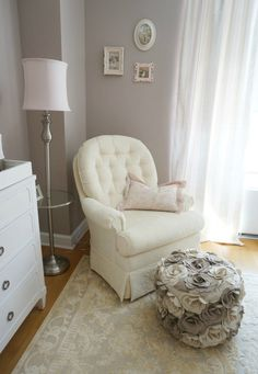 Hours of nursing and rocking babies in the glider absolutely call for a stylish pouf to rest your feet on. We love how our textured flower pouf is used in this twin girl nursery. {Click to shop it}