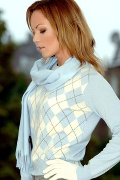 Powder blue and stylishly you. This argyle sweater says it all.