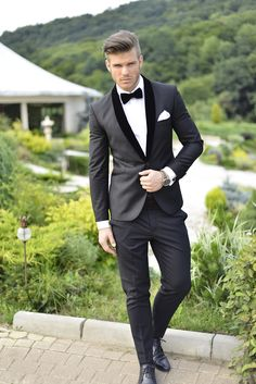Contrast shawl lapel. Simple black slim suit with a rich black velvet lapel and bow tie. Simple and stunning.