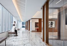 Located on the 36th floor, the Angelo Gordon's Twin Brooks Capital Partners collaboration-focused office has some of the best views of Chicago! The views are accentuated by Architect Stephen Yablon's use of glass partitions, award-winning lighting, and walnut SoundPly Latus Acoustic Wall Panels. #OfficeDesign #SoundPly #Chicago Wood Ceiling Panels, Wood Ceilings, Acoustic Wall Panels, Glass Partition, Showcase Design, Nice View, Collaboration, Architecture Design