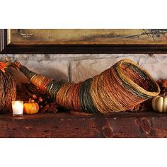 This cornucopia is a beautiful reminder of the abundant blessings we have been given! This natural woven centerpiece is a great addition to your family table! #kirklands #harvest