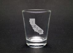 I Like It Here Shot Glass- Home Shot Glass - Moving Gift - Housewarming Gift - Graduation Gift - California Shot Glass. This shot glass is a great reminder of home, or a fun vacation. It is a perfect addition to a new house, a dorm, or an apartment as your loved one moves forward in their life. This design, as with all of our designs, is etched into the shot glass. That makes it a dishwasher-safe permanent design for the life of the shot glass .