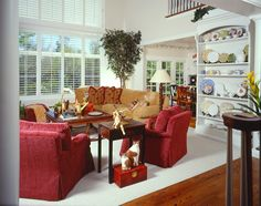 SUZANNE MYERS ELITE INTERIOR DESIGN: Colorful casual family room with a wonderful collection of porcelains.