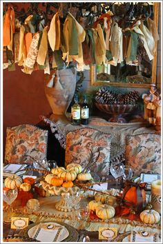 Thanksgiving table.  Love the fabric tied to the chandelier.