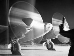 A De Havilland Mosquito PR Mark XVI of No. 140 Squadron RAF warms up its engines in a dispersal at B58/Melsbroek Belgium before taking off on a night photographic-reconnaissance sortie.