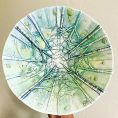 Heesoo Lee beautiful ceramic birch plate.  Heesoo Lee makes wheel-thrown and hand built porcelain vessels covered in delicate and colorful images that draw inspiration from nature and landscapes. These images are created by using layers of underglaze, china paints and metallic lusters.
