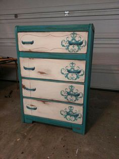 teal and cream chest with flourish on one side of drawers