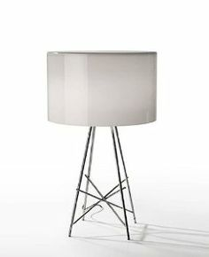 Ray table lamp by Flos by Flos. $1295.00. TOLL FREE Customer service: 1-866-477-1740. FREE WORLDWIDE SHIPPING - FOR A LIMITED TIME ONLY!. No sales tax. Product description: The Ray table lamp has been designed by Rodolfo Dordoni from Flos. This table lamp provides diffused and direct light. Made from Aluminum, this structure features a methacrylic or glass outer shade. A floor version is also available Coming soon ! Details: Manufacturer: Flos Designer: Rodolfo Dordoni - cir...