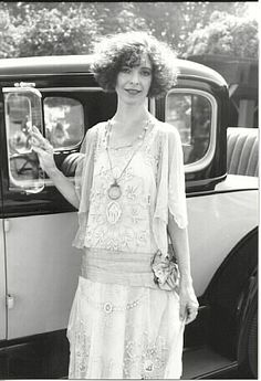 The flapper stereotype is one of short bobbed or shingled hair, straight loose knee-length dresses with a dropped waistline, silk or rayon stockings with garters, heavy makeup, and long beaded necklaces. Flappers are also associated with Jazz and 1920's dances like the Charleston.