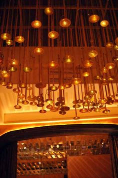 Oh my goodness, golden horns hanging from a ceiling!