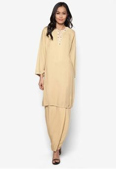 Beads Baju Kurung from Koleksi Kornia in Beige Sparkle your way through the merry occasion with this sweet baju kurung from Koleksi Kornia. Embellished with sparkling beadings on the neckline, giving this number a hint of glam that is traditionally elegant and demure.Top:- Polyblend- Round ne... #bajukurung #bajukurungmoden