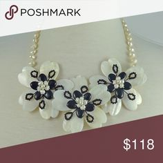 One of a kind statement necklace! This one of a kind statement handmade necklace made from mother of pearls fresh water pearls and crystals is simply gorgeous!!! Jewelry Necklaces