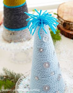 Transform leftover yarn into a festive treescape by coiling it around foam cones. (Designer: Tari Colby) For instructions, purchase your digital issue here: http://www.zinio.com/www/browse/issue.jsp?skuId=416279179&prnt=&offer=&categoryId=