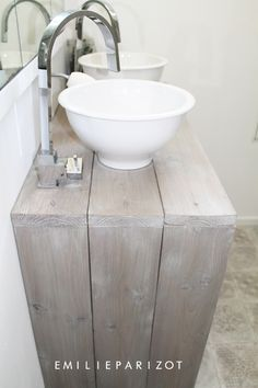 Love the soft wood and silver taps, would change the sinks as they look too much like bowls.