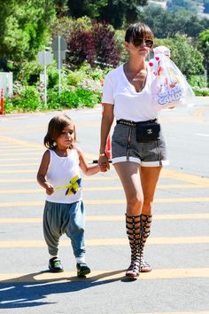 Kourtney Kardashian | Monrow t-shirt from DASH, Finders Keepers shorts from DASH, Stuart Weitzman gladiator sandals, Dita sunglasses from DASH, and a vintage Chanel fanny pack