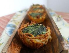 Breakfast finger food: Hash brown nests with spinach and goat cheese.