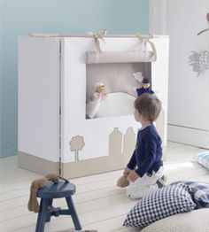 puppet theater made from three plain artist canvases