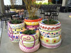 Stacked tire planters with artistic paint work