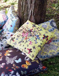 Pile of colorful Christian Lacroix decorative Christian Lacroix butterfly pillows  - Maison - Art de vivre