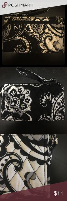 """Vera Bradley Front Zip Wristlet Cute wristlet from Vera Bradley. Black and white. Slight stain? on front, barely noticeable. Only used a few times. 6 credit card slots and one bill slot. One exterior zip pocket.  7 ½"""" w x 4 ½"""" h x 1"""" d with 6"""" wrist strap. Will hold an iPhone 7 or 7+! Vera Bradley Bags Clutches & Wristlets"""