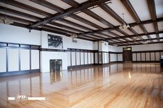 The Governor's Room in Prince of Wales Armouries in Edmonton, Alberta, which has a maximum capacity of 100 people,  marvellous hardwood Maple floors, its gas fireplace, original Rosewood wainscoting, trim and ceiling beams. Just stunning wedding venue!
