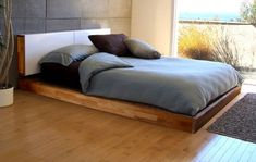 Made using english walnut (shown), birch plywood or espresso european birch, the wall-mounted headboard of the Lax bed by Mash Studios also comes with 1/8-inch thick aluminum sliding doors that are powder-coated in white. Minimalist style with a low profile and natural oil finish, the Lax has extra storage space inside its headboard that acts as a hidden nightstand.