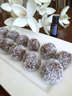 Raw choc peppermint bliss balls using doTERRA Peppermint essential oil. Raw, vegan and gluten-free. A healthy treat to satisfy your sweet tooth! Peppermint Bliss, Doterra Peppermint, Raw Desserts, Delicious Desserts, Yummy Food, Raw Food Recipes, Sweet Recipes, Snack Recipes, Biscuits