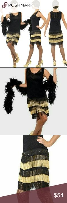 NWT HALLOWEEN COSTUME FLAPPER BEADED GOLD BLACK Embrace the roaring twenties with the 1920's Fringed Flapper Costume. This female 20s inspired fancy dress costume includes a dress with lace front and beaded fringing.  Polyester   Fits US 2-4 Dresses Midi