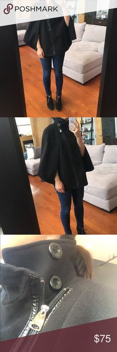 Black Cape coat Beautiful women's Via Spiga black cape coat. Wear it open or fully zipped up to show button collar. Fully lined on inside. 2 openings for arms and 2 faux pockets. Asymmetrical zipper closure with shiny pleather liner.  Size S/M. Via Spiga Jackets & Coats Capes