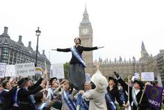 London, 2012: Actors dressed as suffragettes reenacting a march on parliament. | Feminist Photos From Around The World: Then And Now
