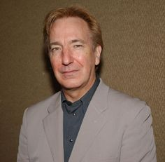 Rickman poses for photographs at a benefit luncheon in New York City on May 14, 2002.