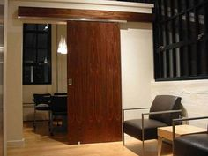 Ingenious Door Sliding System for Saving Valuable Space in Your Home - http://freshome.com/2011/06/03/ingenious-door-sliding-system-for-saving-valuable-space-in-your-home/