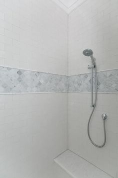 Use pencil tiles on the floor (rather than hexagons)? Marble arabesque shower tiles lined with gray marble pencil tiles accent a white subway tiled shower surround fitted with a polished nickel hand held shower head mounted over a marble bench. Gray Shower Tile, White Subway Tile Bathroom, Subway Tile Showers, Marble Showers, Bathroom Showers, Small Bathroom, Shower Accent Tile, Bathroom Storage, Bathroom Ideas