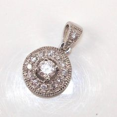 Sterling Silver Clear Clear Stone Shield Charm Pendant - http://jewelry.goshoppins.com/fine-jewelry/sterling-silver-clear-clear-stone-shield-charm-pendant/