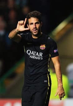 Cesc Fabregas of Barcelona celebrates as he scores their first goal during the UEFA Champions League Group H match between Celtic and FC Barcelona at Celtic Park Stadium on October 1, 2013 in Glasgow, Scotland.