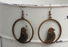 Antique Bronze Bird Dangle Earring by FoxCharmDesigns on Etsy
