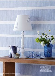 Sanderson 'Tatami Stripe' wallpaper in Country Homes & Interiors July 2014.  A calming blue and white interior creates a beautiful coastal look, perfectly styled with nautical accessories.