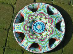 You're colorful. Why shouldn't your car be colorful, too?  #Hubcap #Tires #Art - Very interesting for art in the showroom!