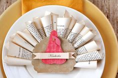 Book Page Turkey Place Cards - Show your Thanksgiving guests that you're thankful for books AND thankful for recycling.