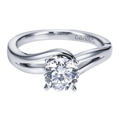 "What a modern ""twist"" on a beautiful classic solitaire! Gabriel & Co."