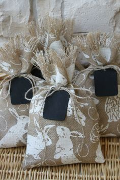 Cute bunny burlap gift bags. I could reuse that burlap fabric I was using as table linen