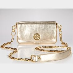 ff32ddd8b Tory Burch Gold Crossover This streamlined Tory burch crossover clutch  shimmers in metallic gold pebbled leather. With a chain link strap.